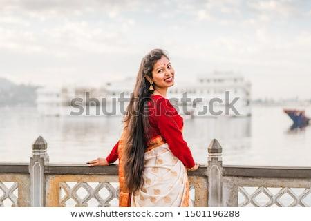 Menina vestido branco lago verde céu primavera Foto stock © RuslanOmega