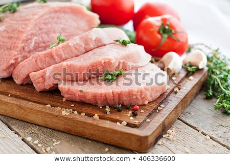 Raw pork tenderloin and vegetables Stock photo © Digifoodstock