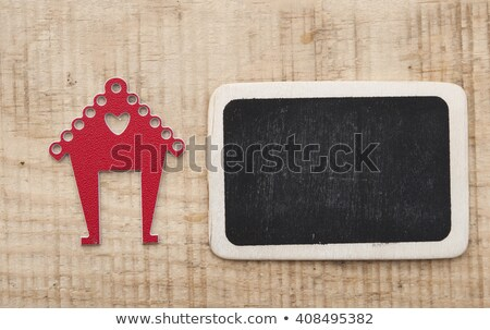 home shape and blank chalkboard on wooden table top stock photo © inxti