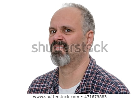 Angry balding man with beard sneers at the camera Stock photo © ozgur