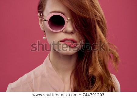 A girl biting her lips Stock photo © bluering