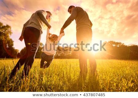 Young beautiful couple in summer park on picnic stock photo © Yatsenko