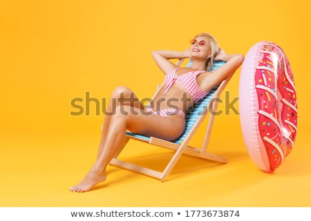 plaj · kadın · bikini · güneşlenme · güverte · sandalye - stok fotoğraf © alphaspirit