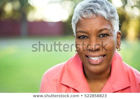 Portré mosolyog gyönyörű afrikai öregasszony nagyi Stock fotó © studiostoks