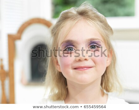 Girl having done her own make-up Stock photo © IS2