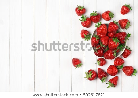 Ripe red strawberries on wooden table. Flat lay Stock photo © Valeriy