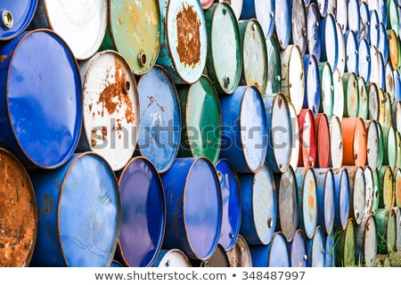 chemical waste dumped in rusty barrels stock photo © wellphoto