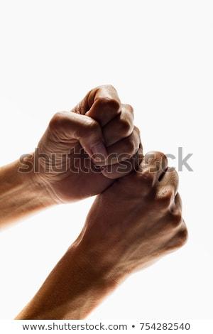 Handen gebaar vuist witte achtergrond close-up Stockfoto © IS2