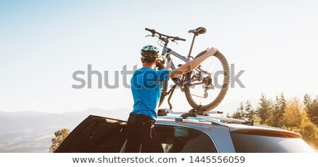 Bicycle on the roof of white car Stock photo © Nobilior