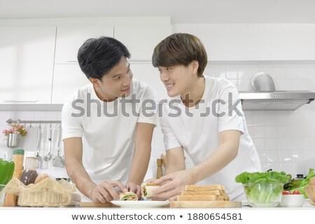 homossexual · casal · alimentação · café · da · manhã · cozinhar · cozinha - foto stock © diego_cervo