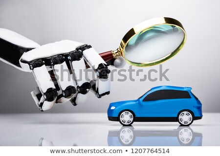 Robot Examining Blue Car Stock photo © AndreyPopov