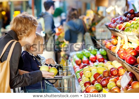 Boy Buying Vegetables and Fruits at Farmers Market Stock photo © artisticco