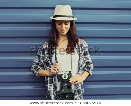 Portrait of young woman 20s wearing straw hat holding retro came Stock photo © deandrobot