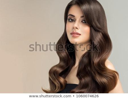 Young beautiful brunette girl in the salon makeup Stock photo © ruslanshramko