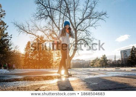 Nő lépés pocsolya víz hó beszél Stock fotó © Kzenon