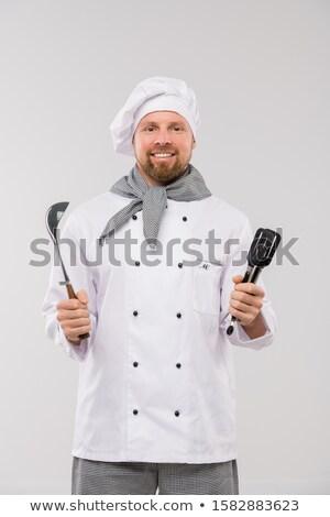 Udany młodych brodaty kucharz uniform Zdjęcia stock © pressmaster