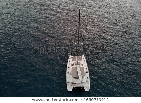View from above drone point of view of white luxury catamaran in Stock photo © amok