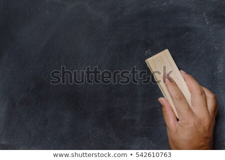 blank blackboard with white chalk eraser smudges stock photo © bbbar