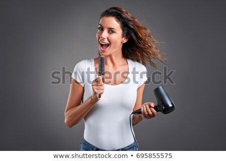 Happy woman holding hairdryer Stock photo © photography33