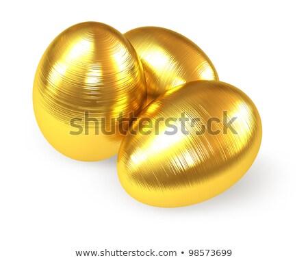 golden fluted eggs isolated on white background stock photo © leonardi