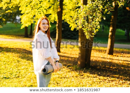 Young caucasian woman in a park with soft summer light Stock photo © hangingpixels