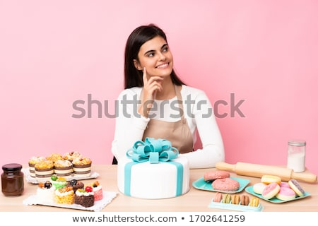 Clueless cook sitting at a table Stock photo © photography33