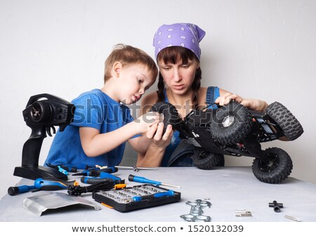 Young mother with her son and a remote controlled car Stock photo © photography33