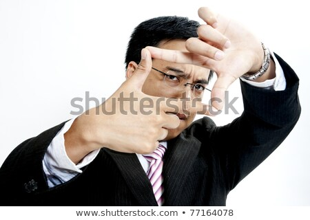 Businessman making a frame with his hands Stock photo © photography33