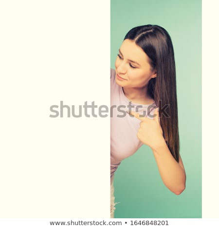 Stockfoto: Mooie · vrouw · wijzend · boord · permanente · witte · vrouw