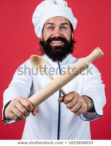 Man in chef uniform using rolling pin Stock photo © wavebreak_media