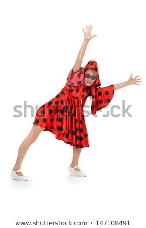 teen girl dancing in a red polka-dot dress with sunglasses Stock photo © RuslanOmega