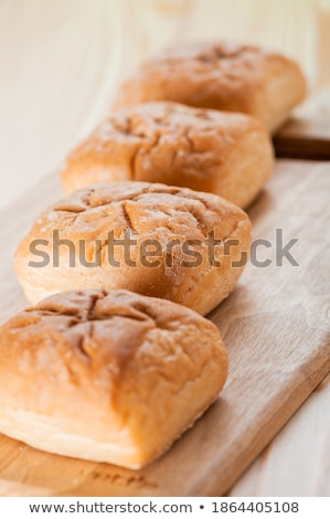 Four Buns Bread on Board Stock photo © milsiart