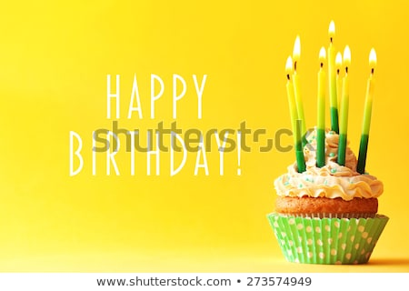 Stock photo: decorated birthday table with candles in the birthday cake