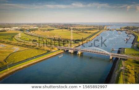 green landscape with water and bridge from above the netherlands stock photo © gigra