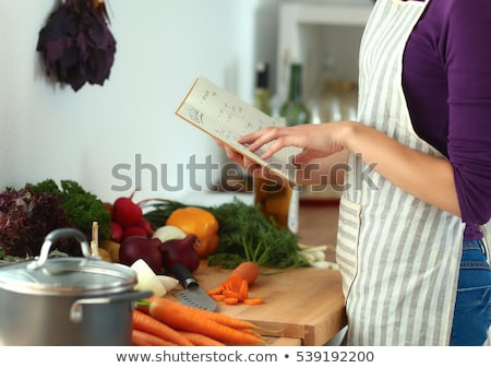 Young woman reads cookbook Stock photo © Witthaya