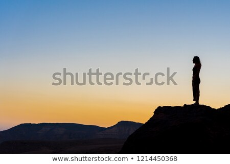 Stock photo: Realxed woman looking at the sunset
