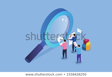 businessman looking at tablet with magnifying glass stock photo © wavebreak_media