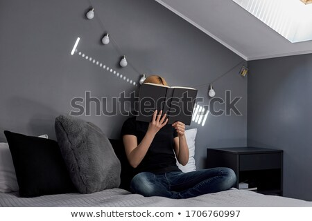 Stock photo: Blond Woman Leaning on her Hand on a Pillow