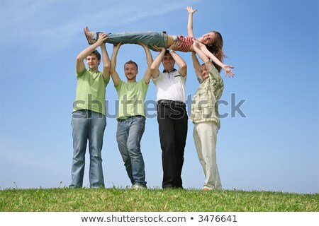 Four friends have lifted the girl upwards Stock photo © Paha_L