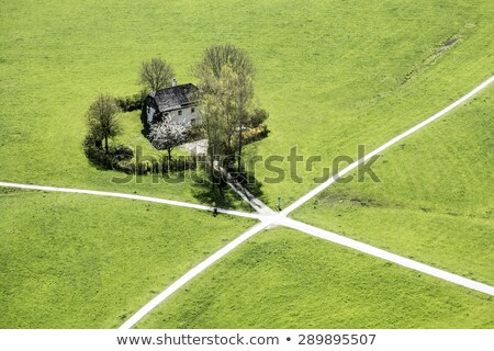 aerial view to house with crossing bicycle ways  Stock photo © meinzahn