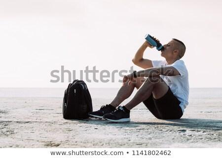 homme · séance · plage · seuls · vide - photo stock © deandrobot