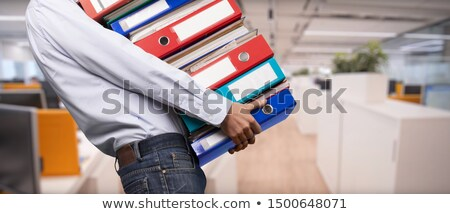 Businessman with archive files in document ring binder Stock photo © stevanovicigor