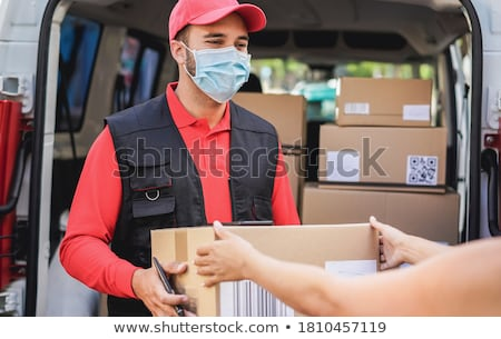 Delivering service with deliveryman and trucks Stock photo © bluering