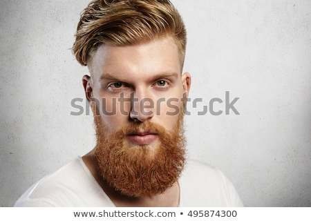 portrait of young bearded hipster guy smiling on white background close up isolated, lifestyle real  Stock photo © iordani