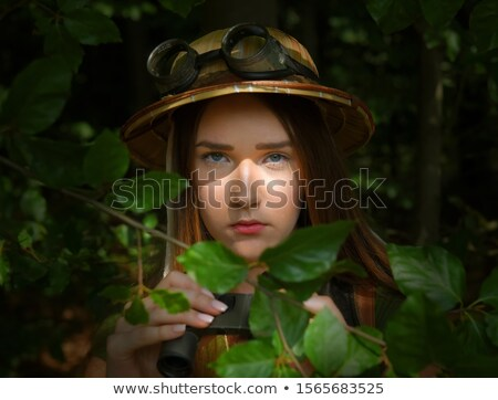 explorer girl with camouflage hat and binoculars stock photo © nicoletaionescu