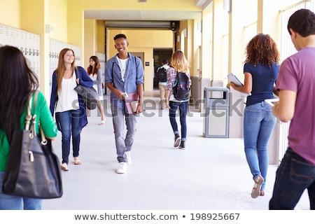 Happy female student walking in the hallway Stock photo © wavebreak_media