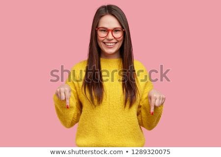 счастливым случайный женщину указывая оба рук Сток-фото © feedough