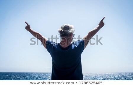 Caucasian hippie woman standing with raised arms. Stock photo © RAStudio