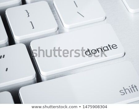 Charity - Aluminum Keyboard Concept. Stock photo © tashatuvango