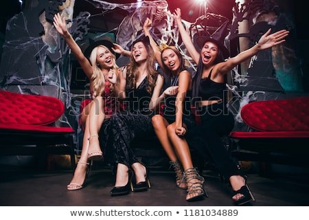 Emotional young women in halloween costumes Stock photo © deandrobot